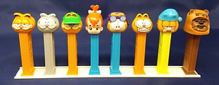 White PEZ Rails for Holding PEZ Dispensers Upright For Display